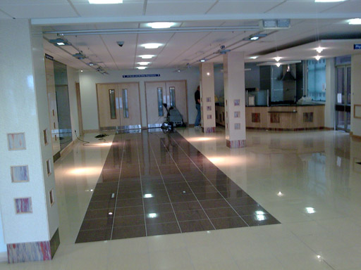 Non Slip Porcelain Tiles On Polished Hospital Entrance